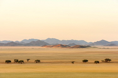 Africa, Namibia, Namib Rand area. Farm Kanaan. Landscape of the Tiras mountains and a river bed.