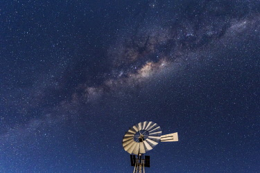 NAM6612AW Africa, Namibia, near Keetmanshop. Milky way with waterpump