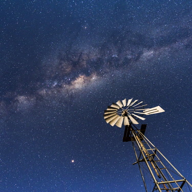 Africa, Namibia, near Keetmanshop. Milky way with waterpump