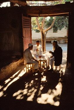 HMS3263176 China, Xinjiang Autonomous Province, 1995 Three old men have tea in the Uzum district of Turpan