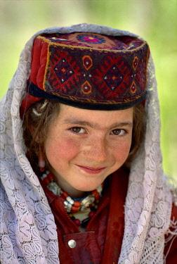 HMS3263219 China, Xinjiang Autonomous Province, 1995 Portrait of a Tajik schoolgirl in Gurtuchlugh