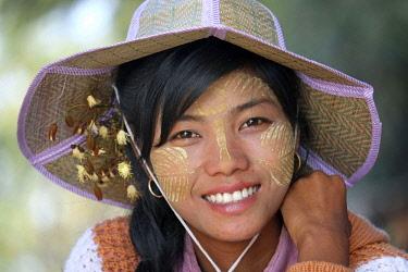 HMS2650692 Myanmar, Mandalay, Mandalay Province, girl with thanaka on her face,