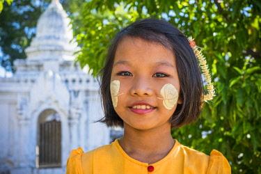HMS3012828 Myanmar (Burma), Mandalay region, Mandalay, girl with thanaka on her face