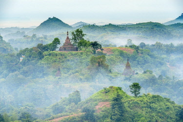 HMS3037638 Myanmar (Burma), Rakhine state (or Arakan state), archeological site of Mrauk U, ancient capital of Rakhine from the 15th to 18th century known as the Golden City, morning mist over the surrounding hi...