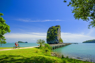 HMS3252266 Thailand, Satun province, Tarutao National Marine Park, Ko Tarutao island, bike ride to Ao Talo Wow, karst rock emerging from the ocean