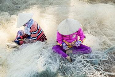 HMS2479790 Vietnam, Binh Thuan province, near Mui Ne, fishing nets repair