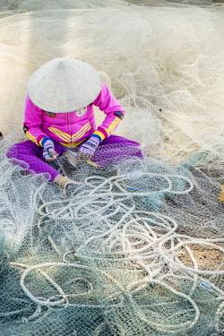HMS2479791 Vietnam, Binh Thuan province, near Mui Ne, fishing nets repair