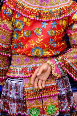 HMS3217100 Vietnam, Lao Cai province, Sin Chen ethnic market, flower Hmongs tribal people
