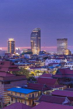 CM02138 Cambodia, Phnom Penh, elevated city skyline, dusk