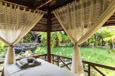 CM02236 Cambodia, Battambang, Wat Kor Village, garden spa, massage area