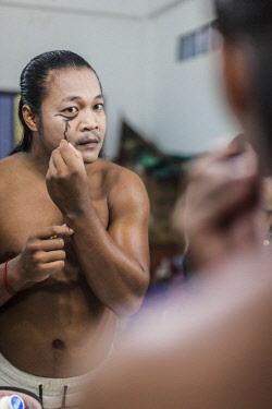 CM02240 Cambodia, Battambang, Phar Ponleu Selpak, arts and circus school, young acrobat applying makeup before circus performance, ER