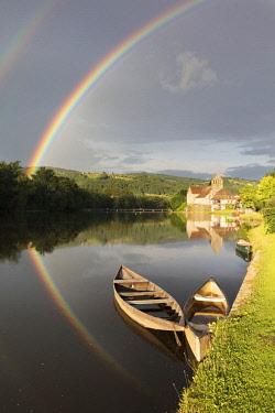 FRA10450AW Europe, Nouvelle-Aquitaine, Correze,  France,  Dordogne Valley, Dordogne river, Beaulieu-sur-Dordogne,  a rainbow over the Chapelle des Penitents