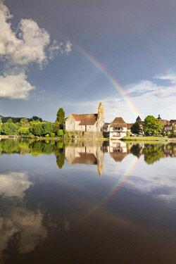 FRA10448AW Europe, Nouvelle-Aquitaine, Correze,  France,  Dordogne Valley, Dordogne river, Beaulieu-sur-Dordogne,  a rainbow over the Chapelle des Penitents