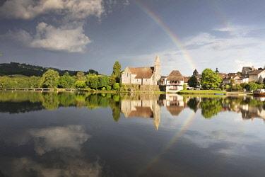 FRA10449AW Europe, Nouvelle-Aquitaine, Correze,  France,  Dordogne Valley, Dordogne river, Beaulieu-sur-Dordogne,  a rainbow over the Chapelle des Penitents