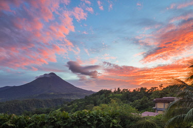 CR33267AW Costa Rica, Alajuela, La Fortuna. The Arenal Volcano at sunset, seen from The Springs Resort and Spa. Although classed as active the volcano has not shown any explosive activity since 2010.