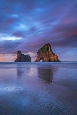 CLKFV90009 Sunset clouds above Archway Islands. Wharariki beach, Puponga, Tasman district, South Island, New Zealand.