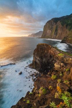 CLKFV91585 Cliffs on the Atlantic Ocean at dawn. Faial, Santana municipality, Madeira Island, Portugal.