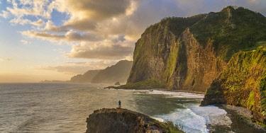 CLKFV91620 Man taking pictures at dawn. Faial, Santana municipality, Madeira Island, Portugal. (MR)