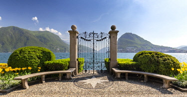 CLKMC90465 View of the old gates of Parco Ciani in Lugano city on a spring day, Canton Ticino, Switzerland.