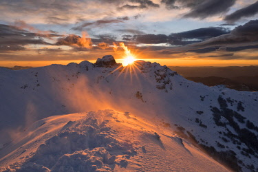 CLKCC92001 magic winter sunset over Gendearme mountain, Cerreto Laghi, municipality of Ventasso, Reggio Emilia Province, Emilia Romagna District, northen  Italy