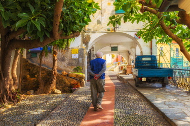 CLKFB88548 An elderly man walks in the historic center of Cervo, Imperia province, Liguria, Italy