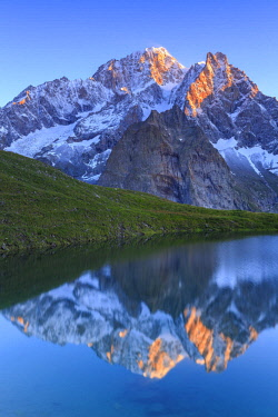 CLKFB90948 The Mont Blanc is reflected in Lac Checrouit during sunrise. Checrouit Lake, Veny Valley, Courmayeur, Aosta Valley, Italy