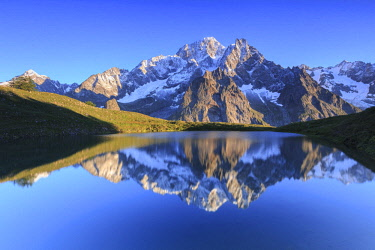 CLKFB90950 The sunlit Mont Blanc is reflected in Lac Checrouit. Checrouit Lake, Veny Valley, Courmayeur, Aosta Valley, Italy