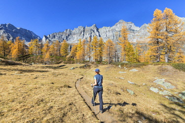CLKGP88170 A girl is walking near the Nero Lake in the Alpe Veglia and Alpe Devero Natural Park (Buscagna Valley, Alpe Devero, Baceno, Verbano Cusio Ossola province, Piedmont, Italy) (MR)