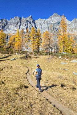 CLKGP88182 A girl is walking near the Nero Lake in the Alpe Veglia and Alpe Devero Natural Park (Buscagna Valley, Alpe Devero, Baceno, Verbano Cusio Ossola province, Piedmont, Italy) (MR)