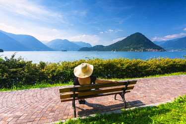 CLKMR90997 Woman on the bench in Iseo lake, Lombardy district, Brescia province, Italy. (MR)