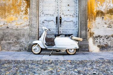 CLKRM91083 White Lambretta Innocenti scooter in the old town, Morbegno, province of Sondrio, Valtellina, Lombardy, Italy,