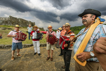 POR9821AW Musicians playing traditional music during the Rye Harvest Festival. Lindoso, Peneda Geres National Park. Alto Minho, Portugal