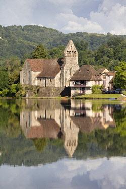 FRA10475AWRF Europe,Nouvelle-Aquitaine,  France, Correze, Dordogne Valley, Dordogne River, Beaulieu-sur-Dordogne, Chapelle des Penitents and its reflection