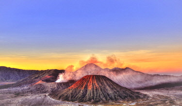 IBXMMW04446966 Sunrise, smoking Mount Bromo, Mt. Batok at front, Mt. Kursi at back, Mt. Gunung Semeru, Bromo Tengger Semeru National Park, Java, Indonesia, Asia