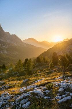 IBXMAB04718197 Sunrise in front of mountain silhouette, view to Monte Cristallo, Passo Falzarego, Falzarego pass, Dolomites, South Tyrol, Trentino-Alto Adige, Italy, Europe