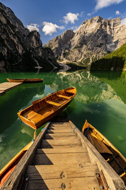 IBXSEI04718795 Stairs in mountain lake with boats, Seekogel peak in the back, Lake Prags, Dolomites, Italy, Europe