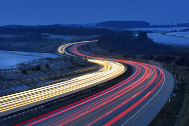IBXAVI04643879 Traces of light on the A9 motorway, curvy road, twilight, winter, long-term exposure, near Schleiz, Thuringia, Germany, Europe