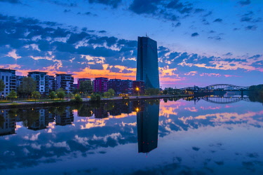 IBXCAG04723482 View across the river Main to the European Central Bank, ECB, in front of sunrise, cloud sky (Altocumulus), Frankfurt am Main, Hesse, Germany, Europe