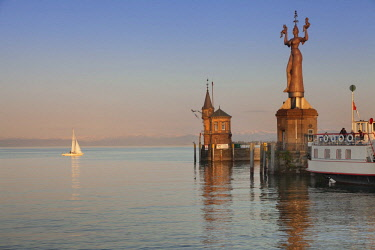 IBXMAL04375298 Harbour entrance, old harbour tower and Imperia statue by Peter Lenk, Constance, Lake Constance, Baden-Wurttemberg, Germany, Europe