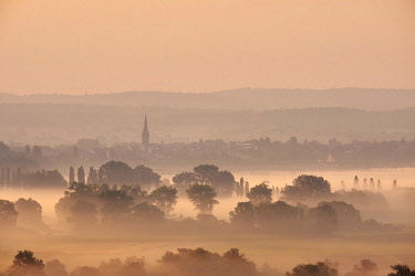 IBXMKL04719865 Early morning fog after sunrise over the Radolfzell Aachried behind Lake Constance with the city of Radolfzell, district of Konstanz, Baden-Wurttemberg, Germany, Europe