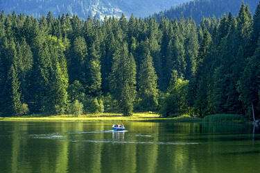 IBXRAI04377763 Spitzingsee with electric boat, Schliersee, Mangfall, Bavarian Prealps, Upper Bavaria, Bavaria, Germany, Europe