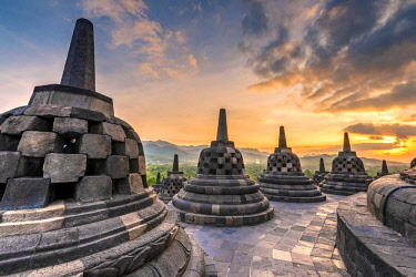 IDA0805AW Stupas at sunset, Candi Borobudur buddhist temple, Muntilan, Java, Indonesia