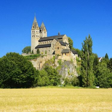IBLAVI04719146 St. Lubentius church in Dietkirchen an der Lahn, in front of barley field, near Limburg an der Lahn, Hesse, Germany, Europe