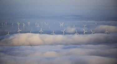 IBLBLO04088524 Wind power plants surrounded by clouds, Marsberg, Sauerland, North Rhine-Westphalia, Germany, Europe