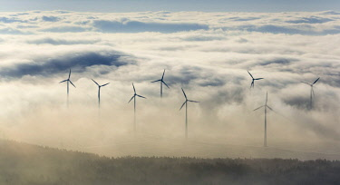 IBLBLO04088538 Wind power plants surrounded by clouds, Bad Wunnenberg, Sauerland, North Rhine-Westphalia, Germany, Europe