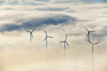 IBLBLO04088541 Wind power plants surrounded by clouds, Bad Wunnenberg, Sauerland, North Rhine-Westphalia, Germany, Europe