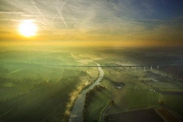 IBLBLO04262672 Ruhr viaduct over Ruhr, Bundesautobahn A52, Sunrise with fog in autumn, Mulheim, Mintard, Ruhr district, North Rhine-Westphalia, Germany, Europe