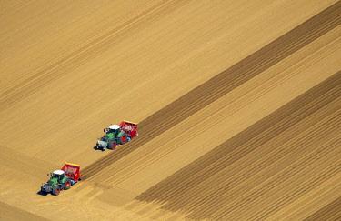 IBLBLO04367485 Aerial view, tractors in a field, arable, harrowing and seeding, Linnich, Lower Rhine, North Rhine-Westphalia, Germany, Europe