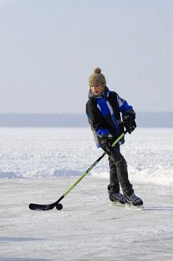 IBLDWB02318040 Boy playing ice hockey, near St. Heinrich, Lake Starnberg, Five Lakes region, Upper Bavaria, Bavaria, Germany, Europe