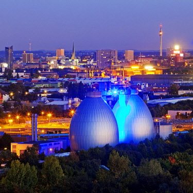 IBLSZI04365724 City viwe with the illuminated digesters of WWTP Dortmund Deusen II, Dortmund, Ruhr district, North Rhine-Westphalia, Germany, Europe